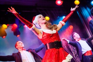 Cromer Christmas show dancer in father christmas outfit