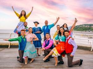 Cromer Pier 2021 cast stood on Cromer Pier in full dress